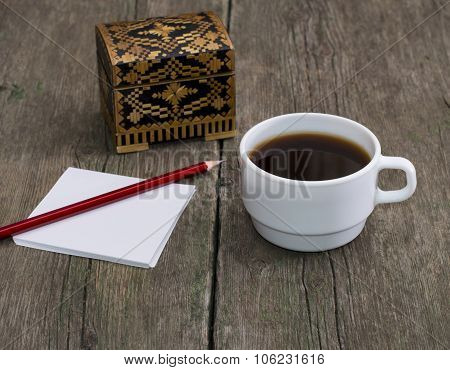 Cup Of Coffee, Pencil With Paper And A Casket, A Still Life, A Subject Drinks