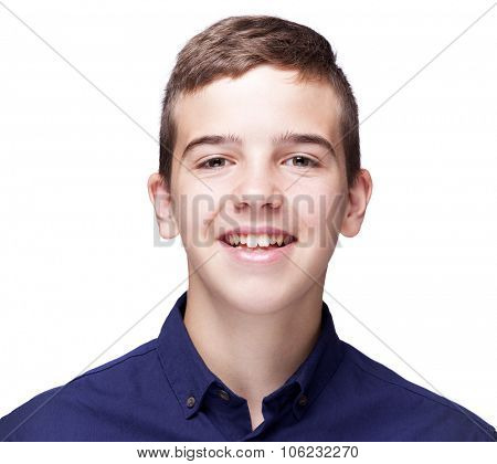 Portrait of a young boy looking at camera and smiling, isolated on white background