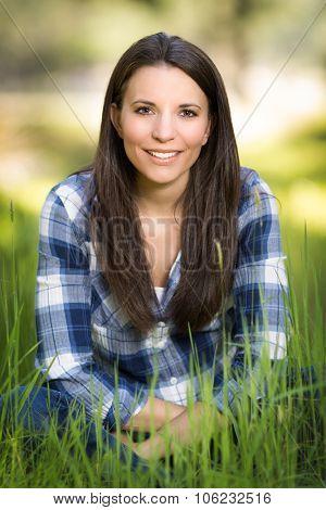 Beautiful woman sitting in long grass