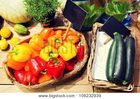 sale, shopping and eco food concept - ripe vegetables in baskets with nameplates at grocery market