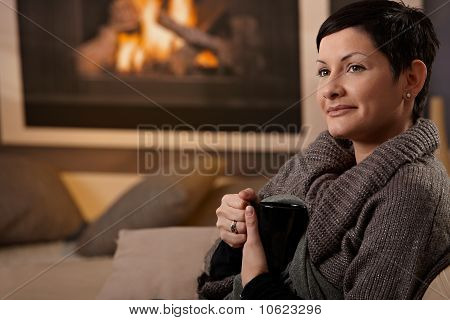 Woman At Fireplace