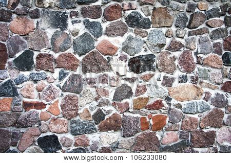 stone wall. texture of colored stones