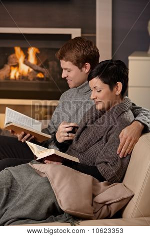 Couple Reading At Home