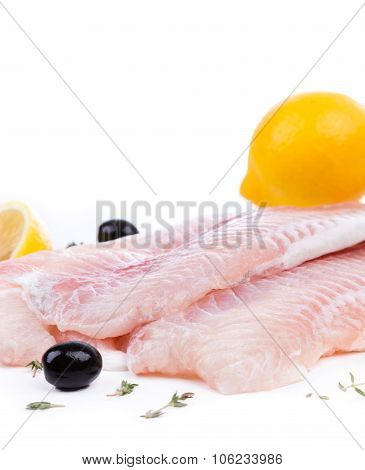 Raw Fillet Of Pangasius With Lemon And Olive