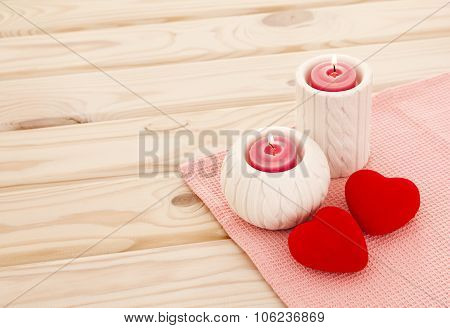 burning candle hearts. Love story concept. Close-up view of red burning candle
