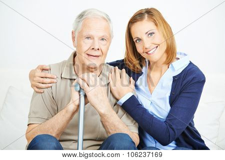 Smiling woman with senior man in a nursing home