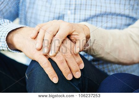 Old senior couple in love holding hands