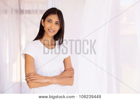 portrait of indian woman with arms crossed at home