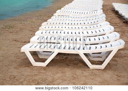 Sunbeds on sea beach at the  resort