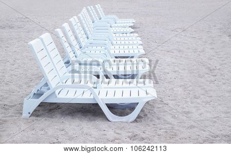 Sunbeds on sea beach in resort