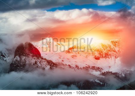 Sunset In The Mountains Of Snow