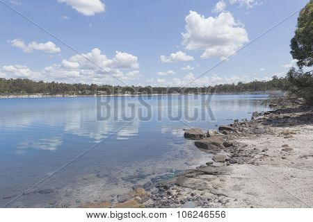 Stockton Lake under White Clouds With Blue Sky