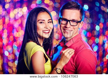 Amorous dates enjoying night party in club