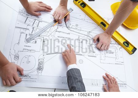 Engineers discussing draft of constructions