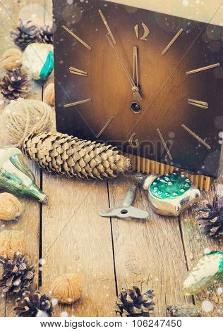 Toys For The Christmas Tree And Pine Cones On Old Wooden Background
