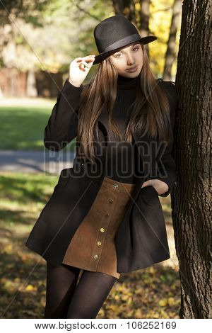 Brunette Beauty In Autumn Clothes.