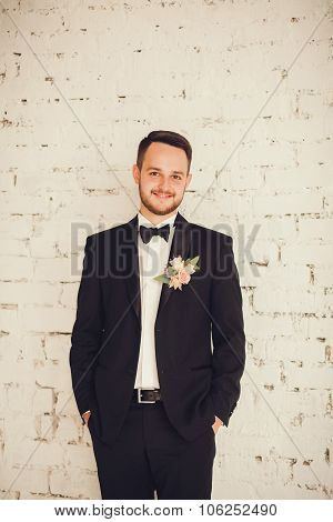 Portrait Of A Smiling Groom In The Room.