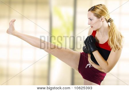 Female Fighter Kicking Leg High Side