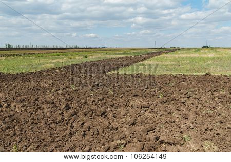 black agriculture field after plowing