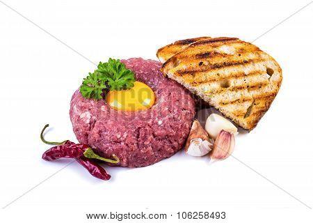 Raw beef .Tasty Steak tartare. Classic steak tartare over white. Ingredients: Raw beef meat salt pep
