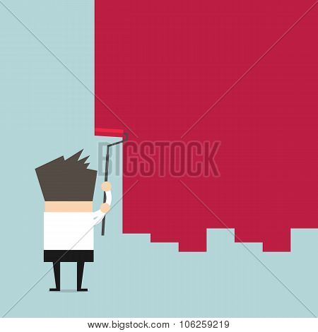 Businessman painting a wall with red paint and a paint roller