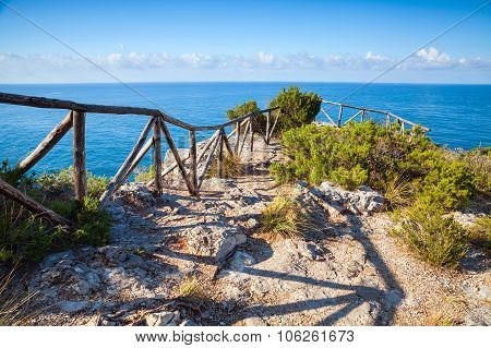 Wooden Railing On Rocky Sea Coast