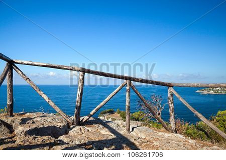 Wooden Railing On Coast Of Mediterranean Sea