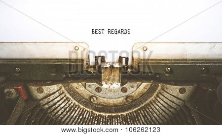 Typewriter And Empty White Paper With A Word Best Regards, Vintage Style
