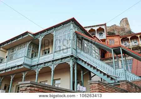 Blue Carved Wooden Balcony Under City Fortress Hill. Tbilisi, Old Town