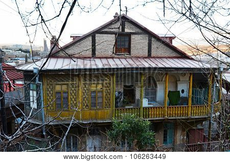 Old House With Carved Wooden Yellow Balcony In Tbilisi, Old Town