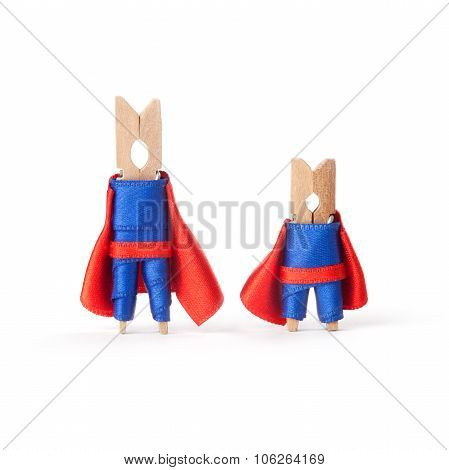 Teamwork, successful business people concept. Superheroes clothespins. white background