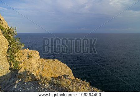 Steep Seacoast Lit By Low Evening Sun.