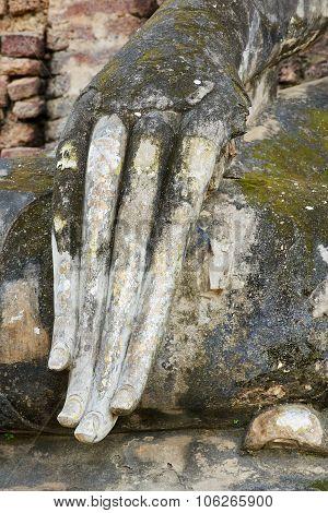 Exterior detail of the Buddha statue at Si Satchanalai temple in Sukhothai historical Park, Sukhotha