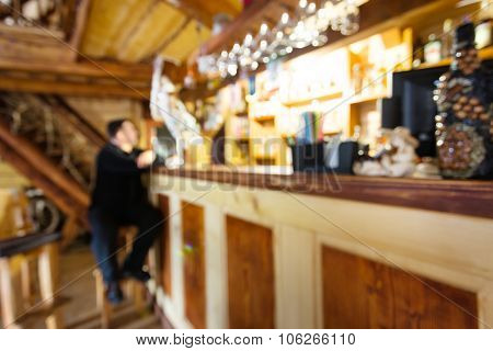 Bar with sitting man