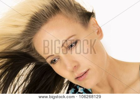 Close Up Of Blonde Woman Hair To Side Look Down