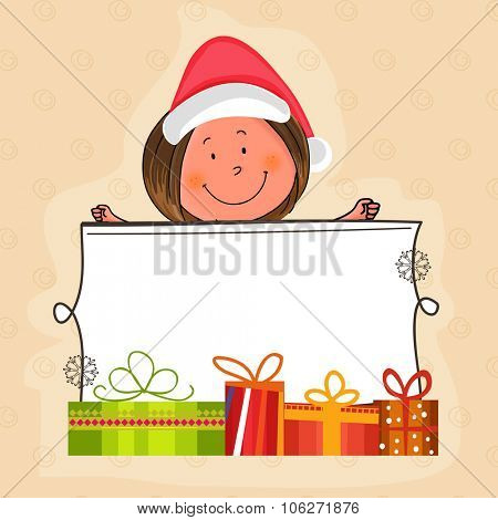 Merry Christmas celebration with cute little girl in Santa cap holding colorful gifts decorated blank board for your message.