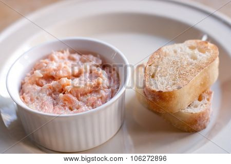Pink salmon rillette. Pate of smoked fish in white plate