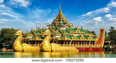 Panorama of Yangon icon landmark and tourist attraction:  Karaweik - replica of a Burmese royal barge at Kandawgyi Lake, Yangon, Myanmar (Burma)