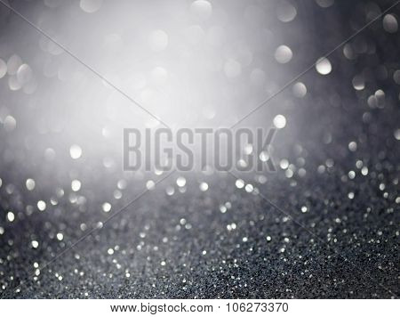 Black and white glittering christmas lights. Blurred abstract background