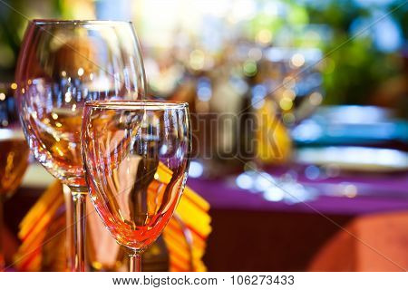 Restaurant interior with wine glasses, closeup.
