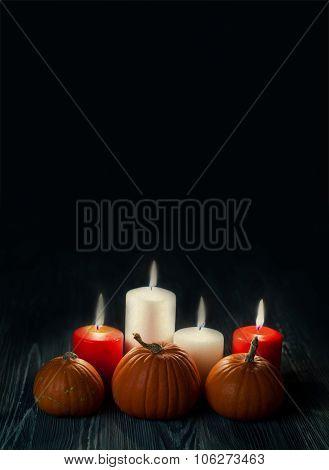 Halloween poster template. Pumpkins, candles in darkness