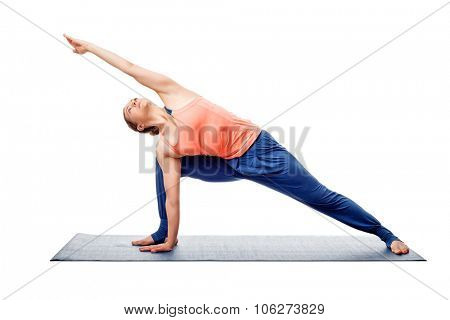 Young fit woman doing Ashtanga Vinyasa Yoga asana Utthita parsvakonasana - extended side angle pose isolated on white