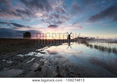 Charming Sunrise Behind Dutch Windmill