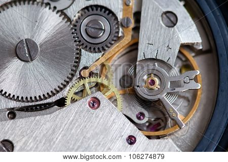 Retro clock mechanism with gears.  Macro view wristwatch.