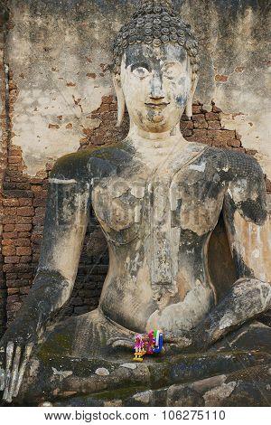 Exterior of the Buddha statue at Si Satchanalai in Sukhothai historical Park, Sukhothai, Thailand.