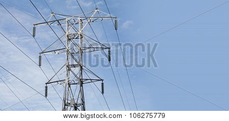 Power lines. High voltage tower with blue sky background. Electricity,  power plant