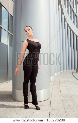 Slender Graceful Ballerina Standing At The Building