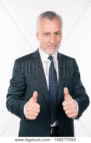 Successful Confident Businessman Showing Thumbs Up And Smiling