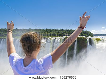 Young Woman With Hands Up At Devil Throat Falls