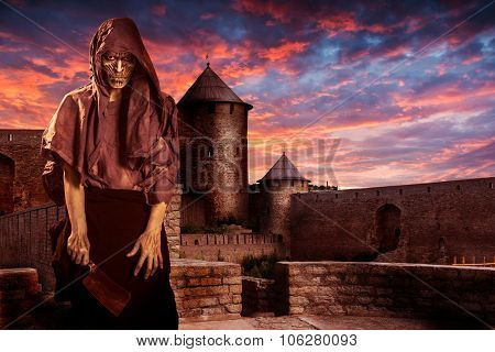 zombie on the ancient castle background. Halloween masquerade